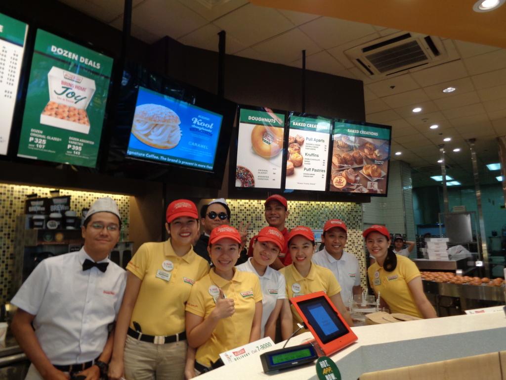 The fun and friendly crew in Krispy Kreme's flagship store in Bonifacio High Street