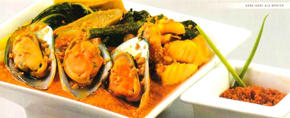 Seafood Kare-Kare Prawns, mussels, white fish and squid and very tasty peanut stew served with Andres bagoong.