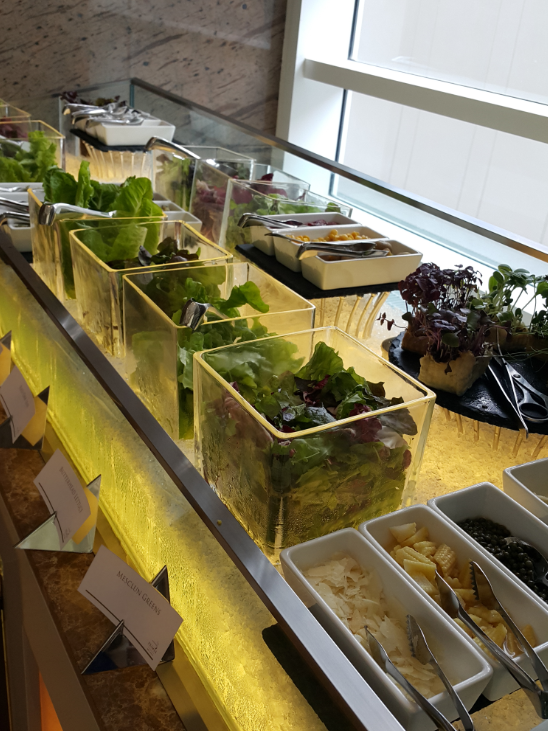 The salad room boasts of an assortment of greens ...