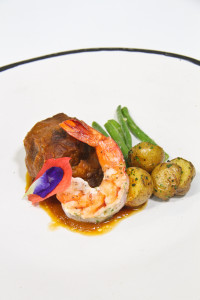 Braised Beef Short ribs with Roasted Garlic Mashed   Potatoes, Grilled Giant Prawns with Herbed Butter, Sautéed Haricot Verts   (French Beans)